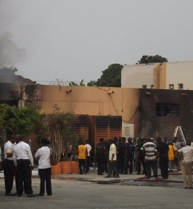 Staff and security men at the scene of the fire