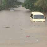 Friday's early morning rain left a large part of Iso Oqua street in Calabar under water. Photo credit: Edet Ikpi