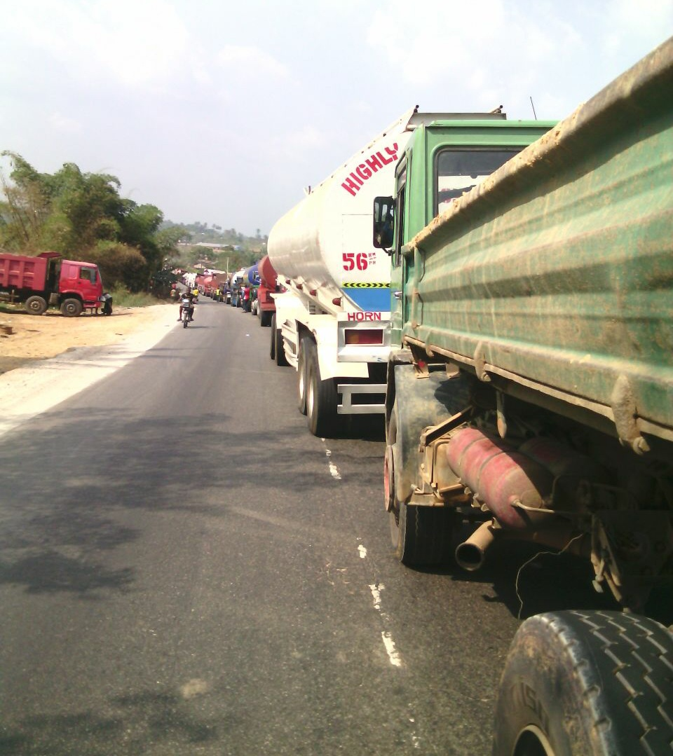 A long line of trucks, stuck on the only access road out of Calabar. Photo credit: Justin A. Obong