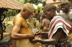 The new Obol Lopon (left) being decorated traditionally, shortly after his selection