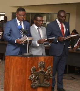 Far left, John Inyang, new Commissioner for Lands, far right, Peter Egba, Commissioner for Commerce and Industry, taking their oath of office at their swearing-in as members of the CRS Executive Council.