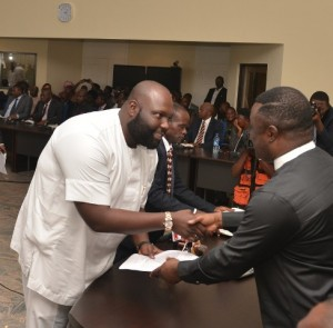 Cross River State Governor, Ben Ayade, shakes the hand of new Commissioner for Finance, Asuquo Ekpenyong Jnr, during the swearing-in ceremony of commissioners at the State Executive Council Chambers, Calabar.