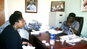 Ojoma Ochai, Director Arts, British Council, briefing CRSHA member, Hilary Bisong
