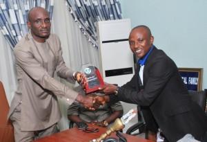 Speaker receiving NESA's iconic award
