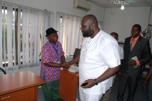 Shakes hands with staff of the Ministry who welcomed him