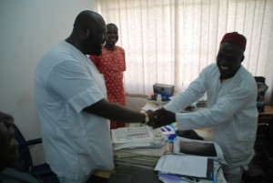 Shakes hands with the Ministry's Internal Auditor