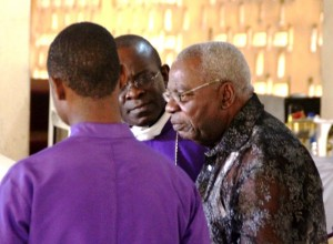 Elder Ebri Eteng is consoled by Fr. Jake Otonko as he breaks down in tears while reading his tribute to the deceased.