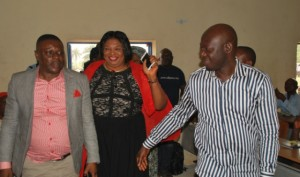 Hillary Bisong, leads two guests, George Ekpungu and Tina Agbor, SSG-CRS, to the Town Hall meeting.
