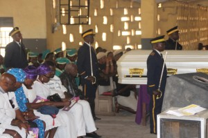 Knights of the Catholic Order of St. John's, stand guard over the corpse in church