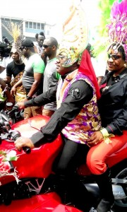 """In a town which gained """"fame"""" for her commercial motorcyclists popularly called """"Alalok"""", it is no surprise that CRS governor, Ben Ayade and wife, Linda, took to their bike as part of the 2015 Calabar Carnival. Photo Credit: Wilson Adams"""