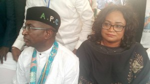 Immediate past Senate Leader, Victor Ndoma-Egba, samples his customised APC cap after formally defecting to the party. Photo credit: Joseph Odok